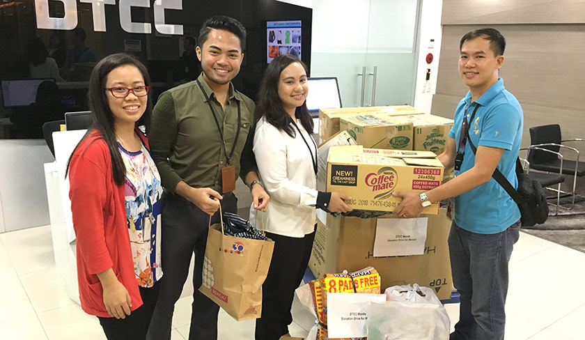 Employees at a food drive